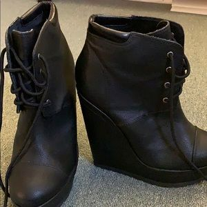 Black 4 1/2 inch heeled ankle booties